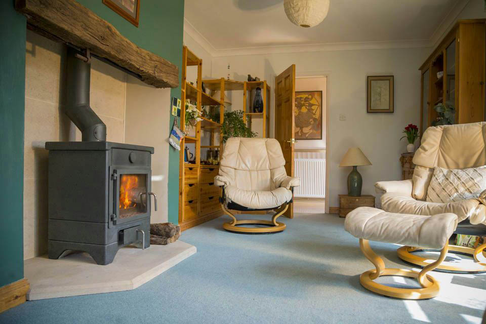 Warm cosy sitting room with a Masonry stove heater